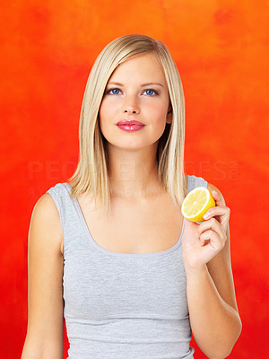 Buy stock photo Portrait of young woman holding slice of lime