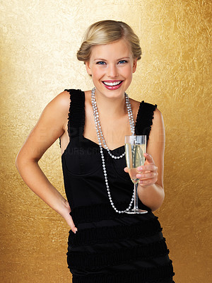 Buy stock photo Young woman posing with champagne glass in hand