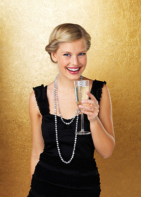 Buy stock photo Young smiling woman holding champagne glass