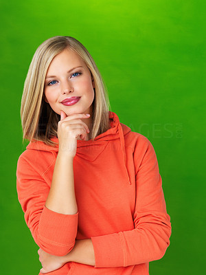 Buy stock photo Pretty woman in hooded sweatshirt posing on green background