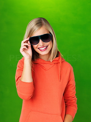 Buy stock photo Pretty woman in hooded sweatshirt holding brim of glasses