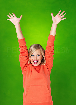 Buy stock photo Beautiful woman holding arms up in excitement