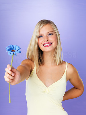 Buy stock photo Portrait of pretty woman offering you with daisy