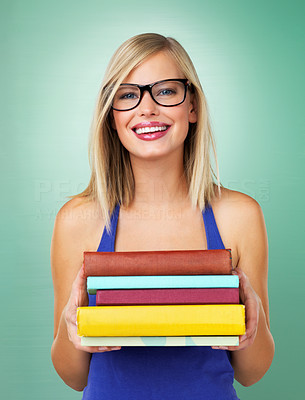 Buy stock photo University girl holding books and smiling on green background