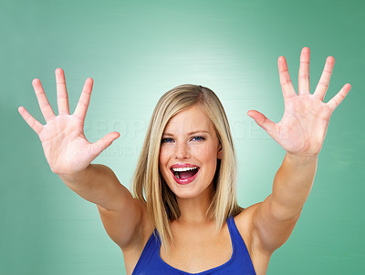 Buy stock photo Woman holding out both arms outstretched