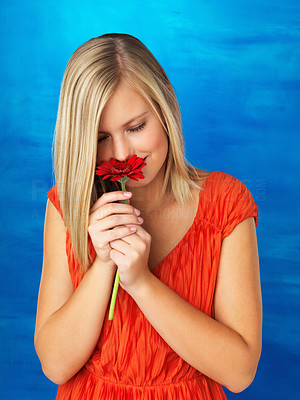 Buy stock photo Pretty woman smelling flower with eyes closed