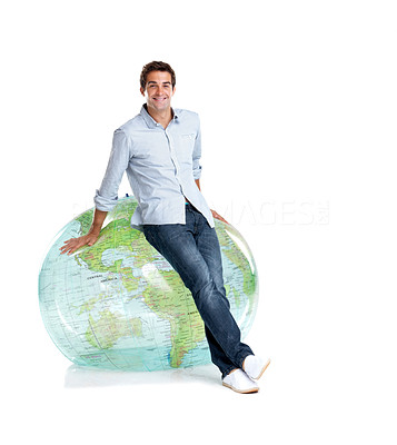 Buy stock photo Portrait of a happy young man sitting on a globe over white background