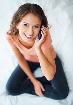 Buy stock photo Top view of happy female student talking on her mobile phone