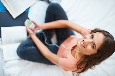Buy stock photo Top view of girl listening to music