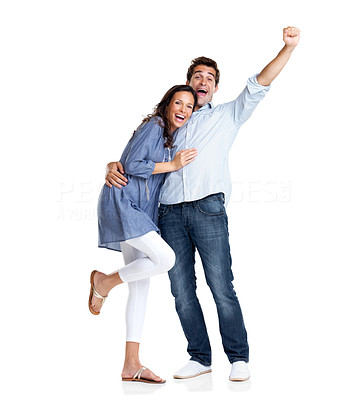 Buy stock photo Portrait of an excited young couple celebrating victory with hands raised on white background