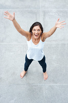 Buy stock photo Top view of a joyful young lady spreading her hands while looking up - Copyspace