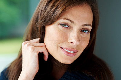 Buy stock photo Closeup portrait of an attractive woman looking relaxed and smiling