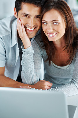 Buy stock photo Portarit of a happy young couple enjoying themselves with laptop