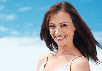 Buy stock photo Portrait of a pretty young lady smiling against the sky - Outdoor