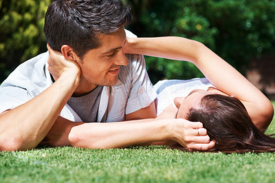 Buy stock photo Portrait of an affectionate young couple having a moment in the park - Outdoor