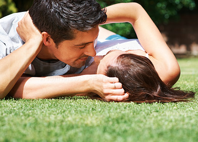 Buy stock photo Portrait of a romantic young couple about to kiss each other in the park - Outdoor