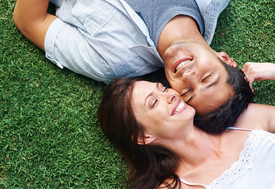 Buy stock photo Portrarit of a happy young couple lying on grass in the park - Outdoor