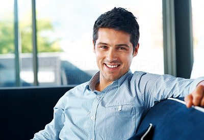 Buy stock photo Portrait of a handsome young man sitting on couch at home - Indoor
