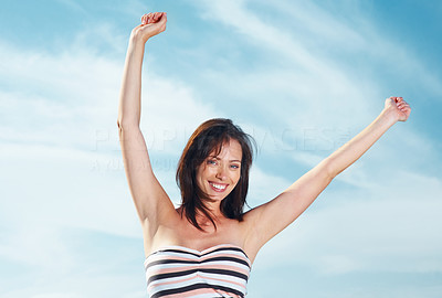 Buy stock photo Portrait of a happy young woman with her hands raised against the sky - Outdoor