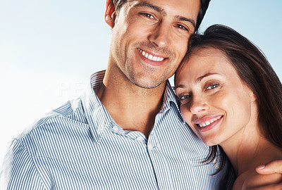 Buy stock photo Closeup portrait of a lovely young couple looking at you with a warm smile - Outdoor
