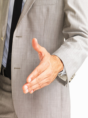 Buy stock photo Business man giving you handshake on white background