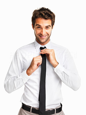 Buy stock photo Happy executive adjusting his tie on white background
