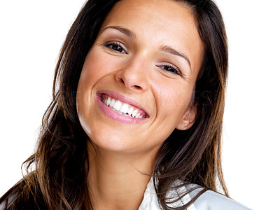 Buy stock photo Closeup portrait of a beautiful young woman smiling against white background