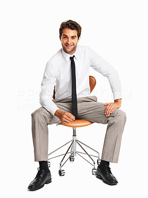 Buy stock photo Confident male executive sitting isolated on a chair