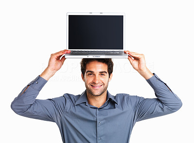 Buy stock photo Happy young man holding laptop over his head on white background