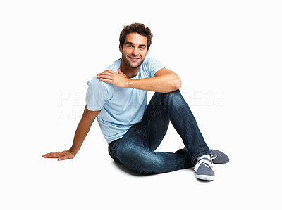 Buy stock photo Casually dressed man sitting on the floor relaxing