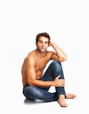 Buy stock photo Serious shirtless man sitting relaxed in blue denim jeans