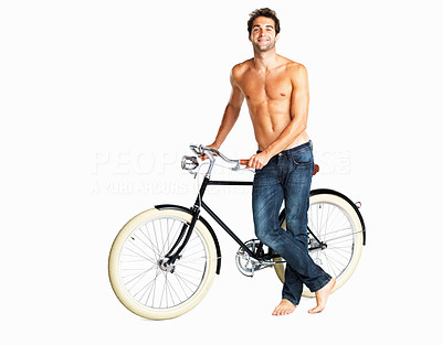 Buy stock photo Smug shirtless man showing off his bike