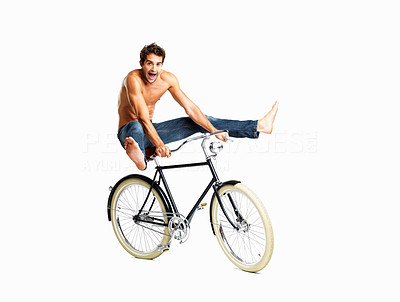 Buy stock photo A fun-loving young man doing tricks on his vintage bike