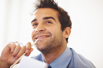 Buy stock photo Closeup portrait of smiling young executive with pencil in hand looking away