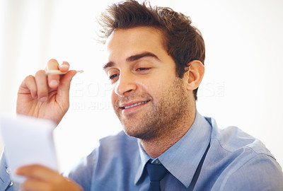Buy stock photo Happy business man looking at the notepad