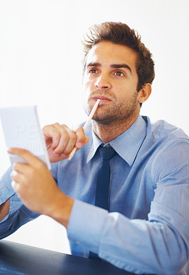 Buy stock photo Portrait of young executive holding pencil and notebook looking up