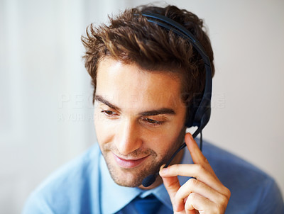 Buy stock photo Closeup portrait of young executive answering on headset