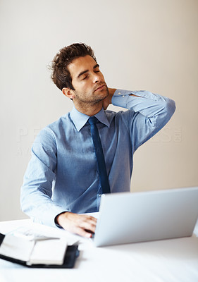 Buy stock photo Young business man with laptop holding neck in pain