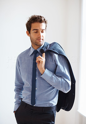 Buy stock photo Serious executive posing with jacket over shoulder