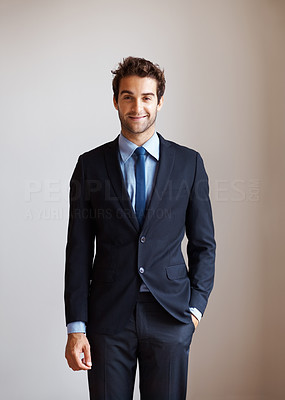 Buy stock photo View of happy executive standing with hand in pocket