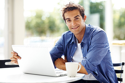 Buy stock photo Portrait of handsome young man working with laptop - Copyspace
