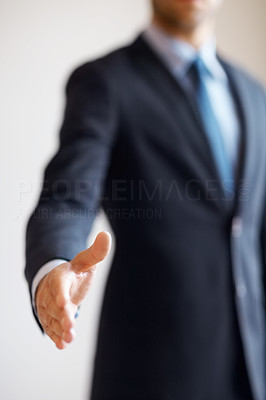 Buy stock photo Businessman extending hand to shake