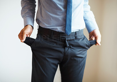 Buy stock photo Businessman holding out pockets