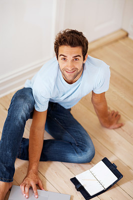 Buy stock photo Top view of man sitting on floor near planner and laptop