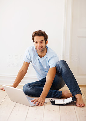 Buy stock photo Man sitting on floor with laptop and planner