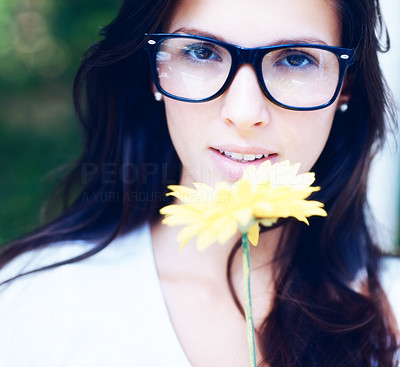 Buy stock photo Beautiful brunette woman wearing retro glasses holding a yellow flower - copyspace