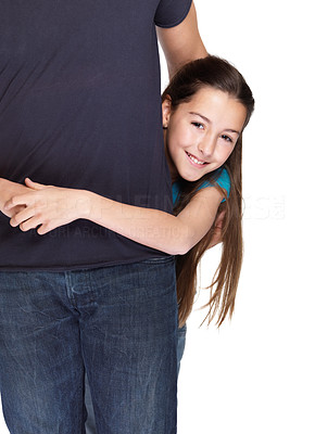Buy stock photo Portrait of a sweet small girl embracing her father from behind against white background