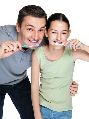 Buy stock photo Portrait of a handsome young man brushing with his daugther against white background
