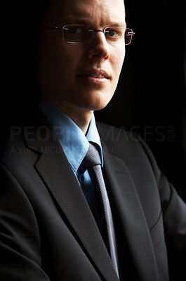 Buy stock photo Authoritative businessman standing in the light of