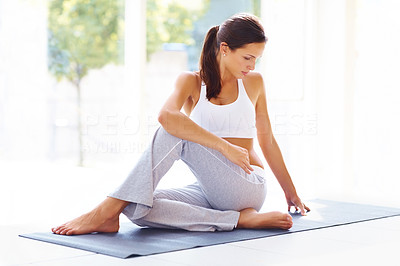 Buy stock photo Portrait of healthy young lady practising yoga exercise - Spine twisting pose